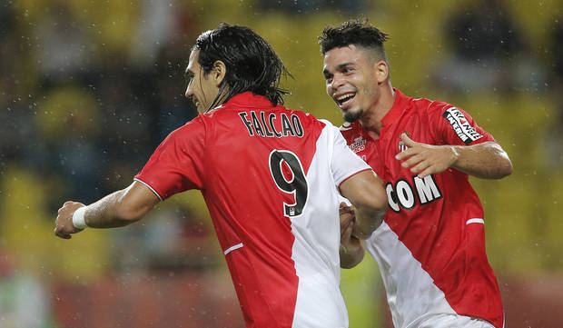 Monaco's Falcao of Colombia is congratulated after scoring the second goal  by his teammate Emmanuel Riviere of France  during their French League One soccer match against Bastia, in Monaco stadium, Wednesday, Sept, 25, 2013. (AP Photo/Lionel Cironneau)