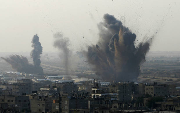 Smoke rises following an Israeli attack on smuggling tunnels on the border between Egypt and Rafah, southern Gaza Strip, Monday, Nov. 19, 2012. (AP Photo/Eyad Baba)