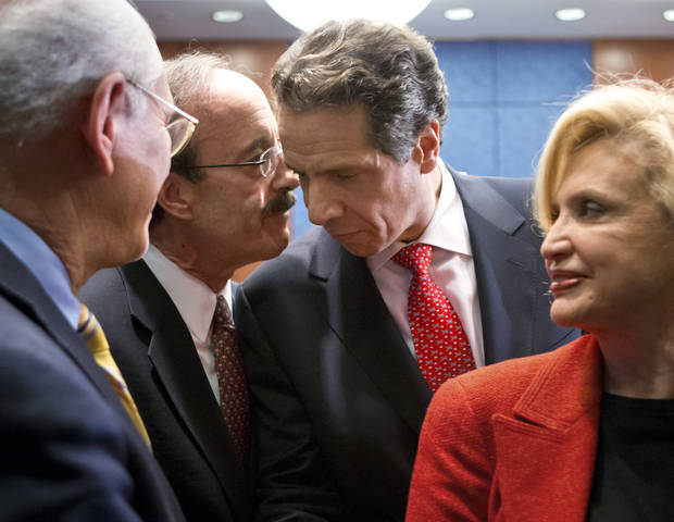 New York Gov. Andrew Cuomo, center, listens to Rep. Eliot Engel, D-NY, following a news conference with the New York Congressional delegation as he comes to the Capitol in Washington to press officials for billions of dollars in aid to help his state recover from the devastation of Hurricane Sandy, Monday, Dec. 3, 2012. Rep. Carolyn B. Maloney, D-NY, is at right. (AP Photo/J. Scott Applewhite)