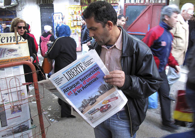 "A man reads a newspaper headlining ""Terrorist attack and kidnapping in In Amenas"", at a news stand in Algiers, Thursday, Jan. 17, 2013. Algerian forces raided a remote Sahara gas plant on Thursday in an attempt to free dozens of foreign hostages held by militants with ties to Mali�s rebel Islamists, diplomats and an Algerian security official said. Information on the Algerian assault in the remote area was wildly varying _ Islamic militants claimed that 35 hostages and 15 militants died in a strafing by Algerian helicopters, while Algeria�s official news service claimed hundreds of local workers and half the foreigners were rescued. (AP Photo/Ouahab Hebbat)"
