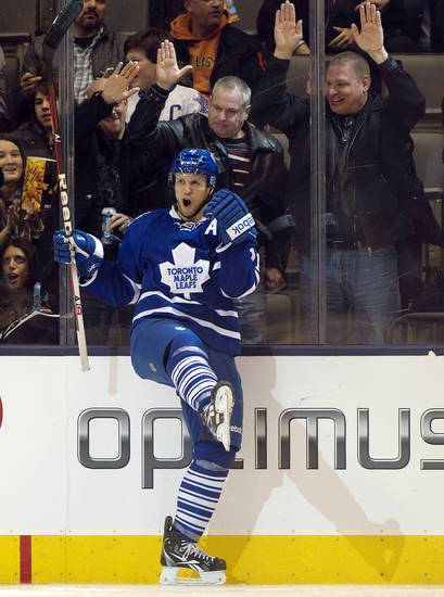Toronto Maple Leafs center Jay McClement celebrates his goal against the New Jersey Devils during the third period of their NHL hockey game, Monday, March 4, 2013, in Toronto. The Maple Leafs won 4-2. (AP Photo/The Canadian Press, Frank Gunn)
