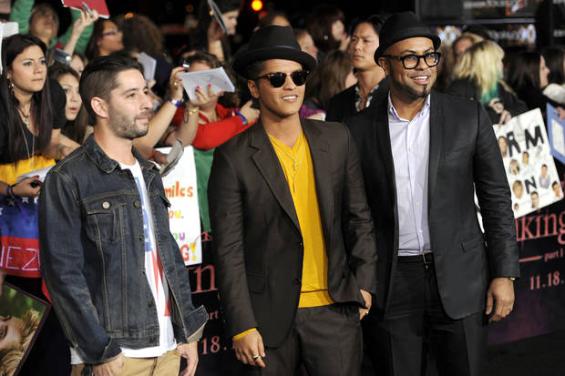 "Bruno Mars, center, and guests arrive to the world premiere of ""The Twilight Saga: Breaking Dawn - Part 1"" on Monday, Nov. 14, 2011, in Los Angeles. (AP Photo/Chris Pizzello) ORG XMIT: CASH208"