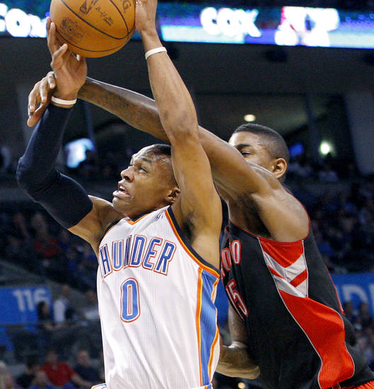 Oklahoma City's Russell Westbrook is fouled by Toronto's Amir Johnson during the second half of their NBA basketball game at the OKC Arena in downtown Oklahoma City on Sunday, March 20, 2011. The Raptors beat the Thunder 95-93. Photo by John Clanton, The Oklahoman