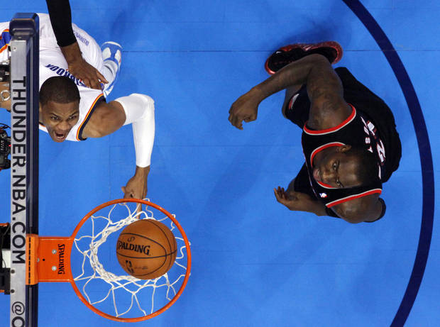 Oklahoma City Thunder's Russell Westbrook (0) scores guarded by Portland Trail Blazers' LaMarcus Aldridge (12) and J.J. Hickson (21) as the Oklahoma City Thunder defeat the Portland Trail Blazers 106-92 in NBA basketball at the Chesapeake Energy Arena in Oklahoma City, on Friday, Nov. 2, 2012.  Photo by Steve Sisney, The Oklahoman