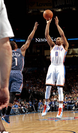 Russell Westbrook (0) shoots guarded by Charlotte Bobcats' Kemba Walker (1)  during the NBA basketball game between the Oklahoma City Thunder and the Charlotte Bobcats at Chesapeake Energy Arena in Oklahoma City, Saturday, March 10, 2012. Photo by Steve Sisney, The Oklahoman