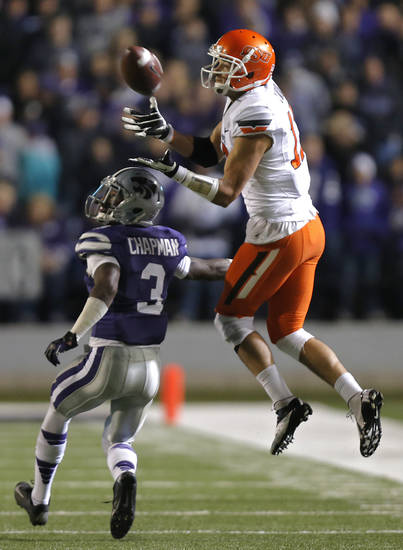 Oklahoma State's Charlie Moore (17) tries to bring in a catch over Kansas State's Allen Chapman (3) during the college football game between the Oklahoma State University Cowboys (OSU) and the Kansas State University Wildcats (KSU) at Bill Snyder Family Football Stadium on Saturday, Nov. 1, 2012, in Manhattan, Kan. Photo by Chris Landsberger, The Oklahoman