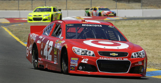 Juan Pablo Montoya of Colombia, drives during practice for the NASCAR Sprint Cup Series auto race Friday, June 21, 2013, in Sonoma, Calif. (AP Photo/Ben Margot)