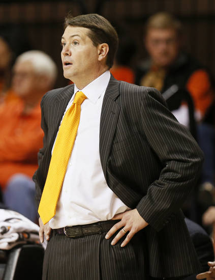 OSU head coach Travis Ford during a men&#039;s college basketball game between Oklahoma State University and Texas Tech at Gallagher-Iba Arena in Stillwater, Okla., Saturday, Jan. 19, 2013. OSU won, 79-45. Photo by Nate Billings, The Oklahoman