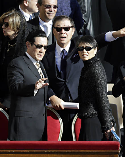 Taiwan's President Ma Ying-jeou, left, and his wife Chow Mei-chin arrive in St. Peter's Square for Pope Francis' inaugural Mass, at the Vatican, Tuesday, March 19, 2013. (AP Photo/Andrew Medichini)