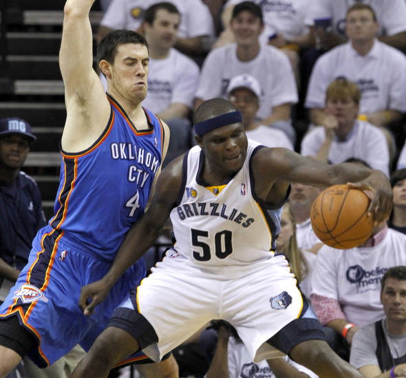 Memphis Grizzlies forward Zach Randolph (50) tries to control the ball as he works against Oklahoma City Thunder forward Nick Collison (4) during the first half of Game 4 of a second-round NBA basketball playoff series on Monday, May 9, 2011, in Memphis, Tenn. (AP Photo/Lance Murphey)