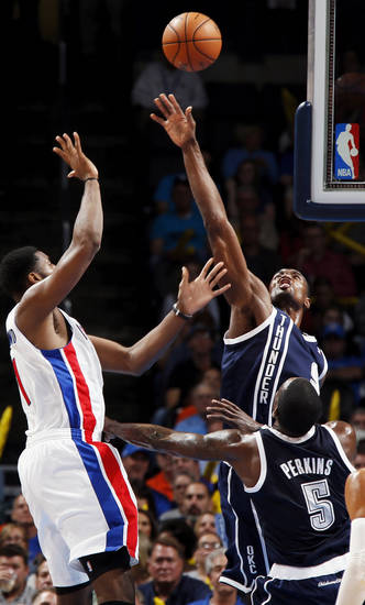 Oklahoma City's Serge Ibaka (9) defends a shot by Detroit's Andre Drummond (1) during an NBA basketball game between the Detroit Pistons and the Oklahoma City Thunder at the Chesapeake Energy Arena in Oklahoma City, Friday, Nov. 9, 2012. Oklahoma City won, 105-94. Photo by Nate Billings, The Oklahoman