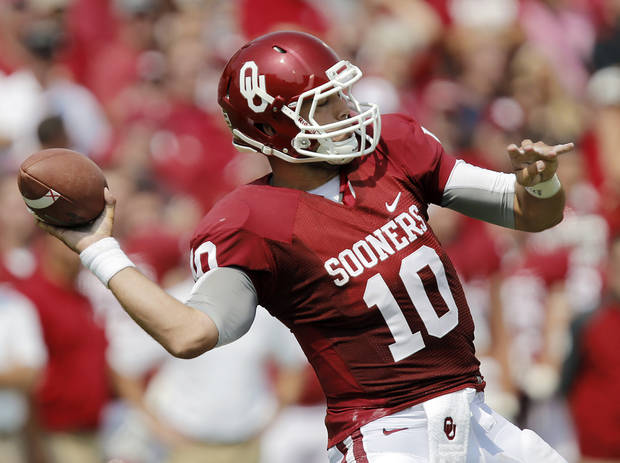 Oklahoma's Blake Bell (10) prepares to throw the ball during the college football game between the University of Oklahoma Sooners (OU) and the University of Tulsa Hurricanes (TU) at the Gaylord-Family Oklahoma Memorial Stadium on Saturday, Sept. 14, 2013 in Norman, Okla.  Photo by Chris Landsberger, The Oklahoman