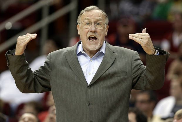 Minnesota Timberwolves coach Rick Adelman questions a call in the first half of an NBA basketball game against the Houston Rockets Friday, March 15, 2013, in Houston. (AP Photo/Pat Sullivan)