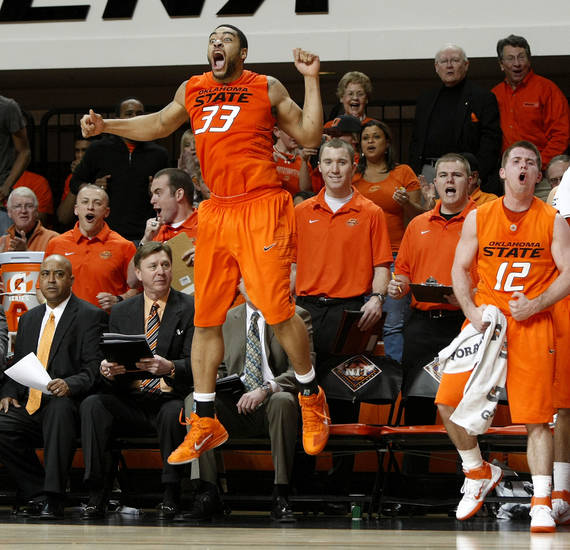 Oklahoma State's Marshall Moses (33) and Oklahoma State's Keiton Page (12) celebrate during a first-round NIT college basketball game between Oklahoma State University (OSU) and Harvard at Gallagher-Iba Arena in Stillwater, Okla., Tuesday, March 15, 2011. Photo by Bryan Terry, The Oklahoman