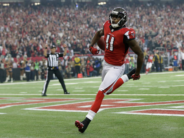 Atlanta Falcons' Julio Jones runs into the end zone after catching a 46-yard touchdown pass during the first half of the NFL football NFC Championship game against the San Francisco 49ers Sunday, Jan. 20, 2013, in Atlanta. (AP Photo/Dave Martin)
