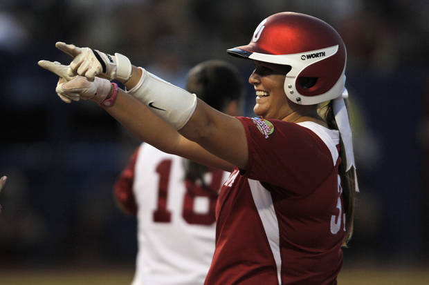 Oklahoma's Katie Norris (33) celebrates during a Women's College World Series game between OU and Alabama at ASA Hall of Fame Stadium in Oklahoma City, Monday, June 4, 2012.  Photo by Garett Fisbeck, The Oklahoman