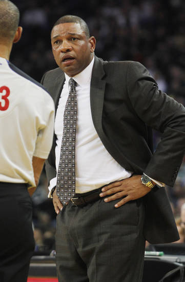 Boston Celtics head coach Doc Rivers talks to an official during the first half of an NBA basketball game against the Golden State Warriors in Oakland, Calif., Saturday, Dec. 29, 2012. (AP Photo/George Nikitin)