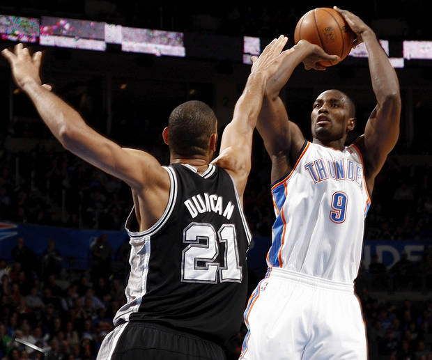 Oklahoma City&#039;s Serge Ibaka (9) shoots against San Antonio&#039;s Tim Duncan (21) during an NBA basketball game between the Oklahoma City Thunder and the San Antonio Spurs in Oklahoma City Monday, Dec. 17, 2012. Oklahoma City won, 107-93. Photo by Nate Billings, The Oklahoman