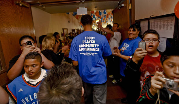 Player Jeremy Lamb is greeted by fans at Ranchwood Nursing Home in Yukon  during the Oklahoma City Thunder's 1,000th community appearance.   Photo by Chris Landsberger, The Oklahoman <strong>CHRIS LANDSBERGER - CHRIS LANDSBERGER</strong>