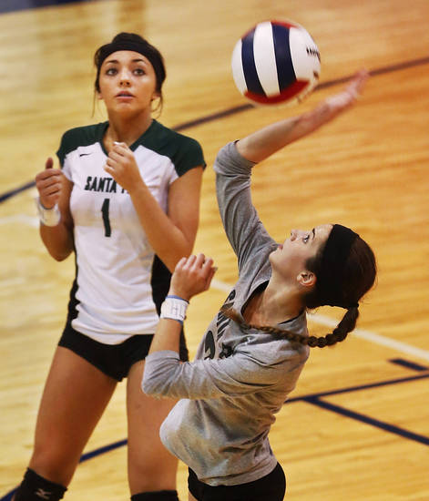 Santa Fe senior  Mandy Dolph makes contact with the ball in front of teammate Samantha Ethridge in first round action during Stillwater vs. Edmond Santa Fe game in Class 6A volleyball tournament at Shawnee High School on Friday, Oct. 12, 2012.   Photo by Jim Beckel, The Oklahoman