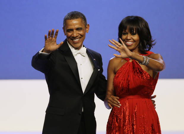 "FILE - In this Jan. 21, 2013, file photo, President Barack Obama and Michelle Obama wave to guests after their dance at the Inaugural Ball at the 57th Presidential Inauguration in Washington. Michelle Obama has a new look, both in person and online, and with the president's re-election, she has four more years as first lady, too. The first lady is trying to figure out what comes next for this self-described ""mom in chief"" who also is a champion of healthier eating, an advocate for military families, a fitness buff and the best-selling author of a book about her White House garden. For certain, she'll press ahead with her well-publicized efforts to reduce childhood obesity and rally the country around its service members. (AP Photo/Paul Sancya, File)"