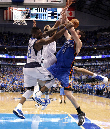 Oklahoma City's Nick Collison (4) is hit by DeShawn Stevenson (92) and Tyson Chandler (6) of Dallas during game 2 of the Western Conference Finals in the NBA basketball playoffs between the Dallas Mavericks and the Oklahoma City Thunder at American Airlines Center in Dallas, Thursday, May 19, 2011. Photo by Bryan Terry, The Oklahoman