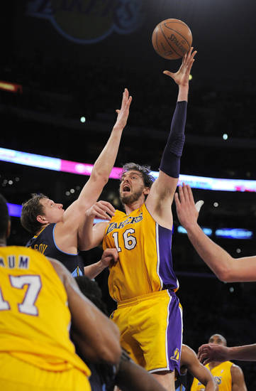 Los Angeles Lakers forward Pau Gasol, right, of Spain puts up a shot as Denver Nuggets center Timofey Mozgov of Russia defends during the first half in Game 5 of an NBA first-round playoff basketball game, Tuesday, May 8, 2012, in Los Angeles. (AP Photo/Mark J. Terrill)