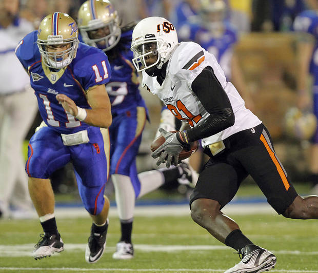 Oklahoma State's Justin Blackmon (81) runs past Tulsa's Alan Dock (11) during a college football game between the Oklahoma State University Cowboys and the University of Tulsa Golden Hurricane at H.A. Chapman Stadium in Tulsa, Okla., Sunday, Sept. 18, 2011. Photo by Chris Landsberger, The Oklahoman