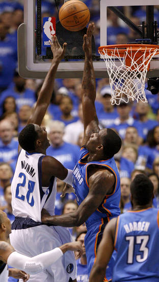 Oklahoma City's Kendrick Perkins (5) defends Dallas' Ian Mahinmi (28) during Game 3 of the first round in the NBA playoffs between the Oklahoma City Thunder and the Dallas Mavericks at American Airlines Center in Dallas, Thursday, May 3, 2012. Photo by Bryan Terry, The Oklahoman