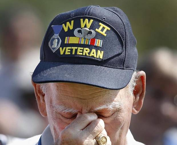 Wearing a hat proclaiming his service in World War II,  U.S. Army veteran Art Levine in a moment of silence during the Memorial Day observance at the 45th Infantry Division Museum at NE 36 and MLK in Oklahoma City, Monday,  May 31, 2010. Photo by Jim Beckel, The Oklahoman ORG XMIT: KOD