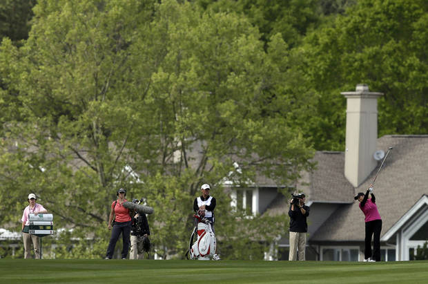 Cristie Kerr, right, hits her second shot on the 15th hole during the third round of the Kingsmill Championship LPGA golf tournament in Williamsburg, Va., Saturday, May 4, 2013. (AP Photo/Steve Helber)