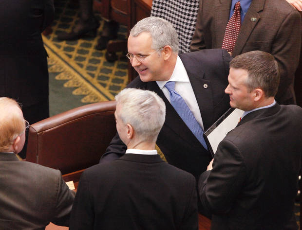 Gov. Brad Henry reaches in to shake hands with Republican legislators as he makes his way out of the chamber after delivering his yearly State of the State message to a joint session of lawmakers in the House chambers at the state capitol Monday afternoon, Feb, 1, 2010.  Photo by Jim Beckel, The Oklahoman