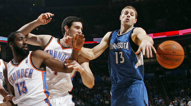 Oklahoma City&#039;s James Harden (13) and Nick Collison (4) chase a loose ball along with Minnesota&#039;s Luke Ridnour (13) during the NBA basketball game between the Minnesota Timberwolves and the Oklahoma City Thunder at the Oklahoma City Arena, Monday, November 22, 2010, in Oklahoma City. Photo by Nate Billings, The Oklahoman