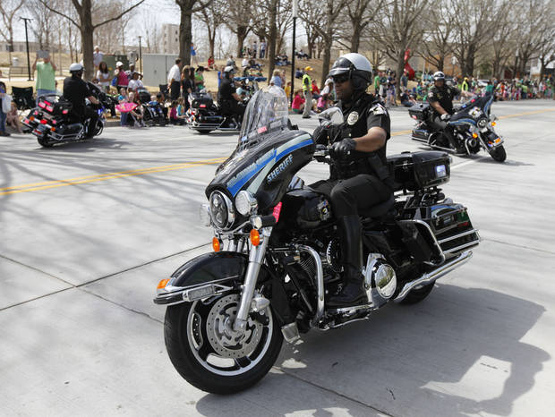 Oklahoma County Sheriff's Deputies rode their motorcycles in formation during the annual Saint Patrick's Day Parade in downtown Oklahoma City, OK, Saturday, March 16, 2013,  By Paul Hellstern, The Oklahoman