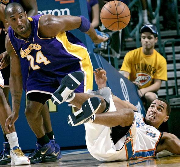 Oklahoma City's Thabo Sefolosha (right) and Los Angeles' Kobe Bryant go after a loose ball during the NBA basketball game between the Los Angeles Lakers and the Oklahoma City Thunder at the Ford Center in Oklahoma City, on Tuesday, Nov. 3, 2009. By John Clanton, The Oklahoman  ORG XMIT: KOD