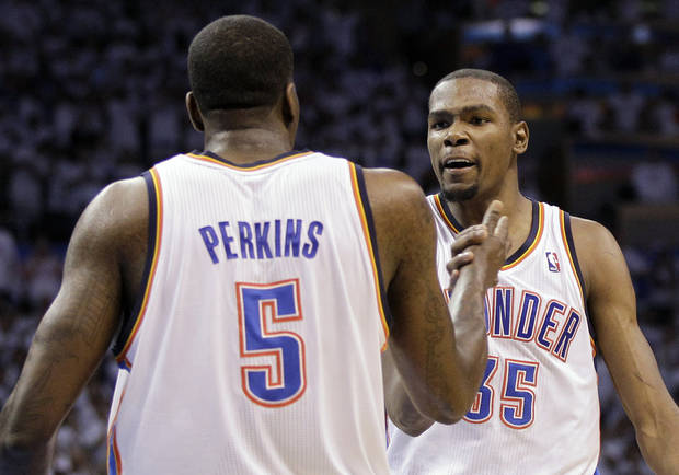 Oklahoma City Thunder small forward Kevin Durant (35) and center Kendrick Perkins (5) celebrate during the final moments against the San Antonio Spurs in Game 6 of the NBA basketball Western Conference finals, Wednesday, June 6, 2012, in Oklahoma City. The Thunder won 107-99. (AP Photo/Eric Gay)