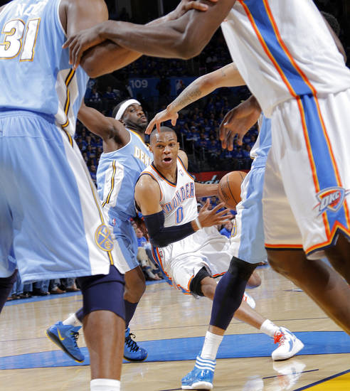 Oklahoma City's Russell Westbrook (0) drives past Denver's Kenyon Martin (4) during the first round NBA playoff game between the Oklahoma City Thunder and the Denver Nuggets on Sunday, April 17, 2011, in Oklahoma City, Okla. Photo by Chris Landsberger, The Oklahoman