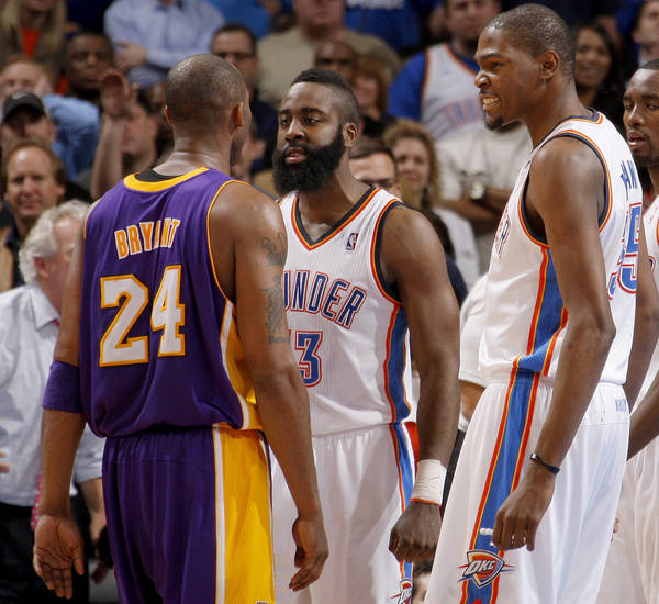 Oklahoma City's James Harden (13) and Kevin Durant (35) reacts next to Los Angeles' Kobe Bryant (24) during an NBA basketball game between the Oklahoma City Thunder and the Los Angeles Lakers at Chesapeake Energy Arena in Oklahoma City, Thursday, Feb. 23, 2012.  Oklahoma City won 100-85. Photo by Bryan Terry, The Oklahoman