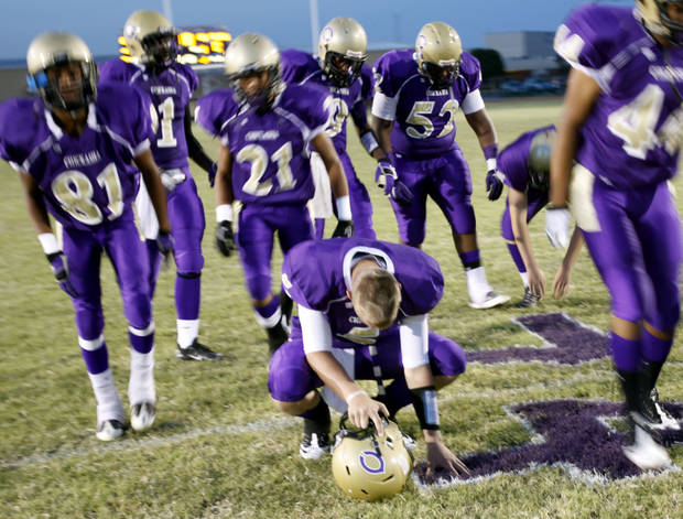 Chase Rodgers, center, touches Kody Turner's number on the field before the football game between Chickasha and Capitol Hill at Chickasha High School, Friday, Oct. 1, 2010. It was the first home game since the death of player Kody Turner. Photo by Sarah Phipps, The Oklahoman