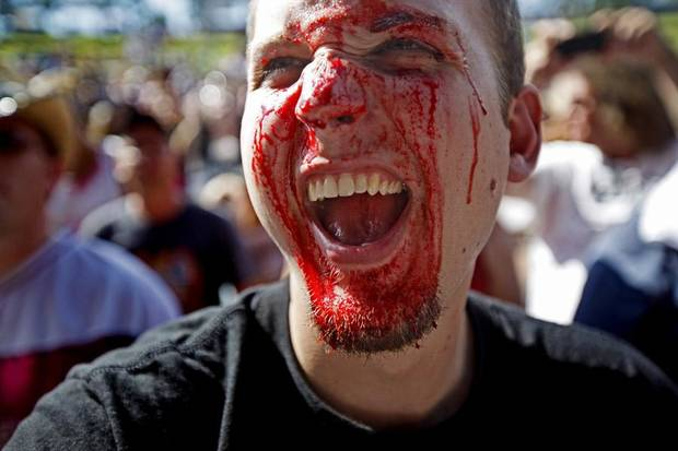 FANS: While covered in fake blood Adam Culbertson of Portsmouth, Ohio, cheers for the band A Fate Far Worse during the Rock-N-America Music Festival at the Zoo Amphitheatre in Oklahoma City, Friday, July 23, 2010.  Photo by Bryan Terry, The Oklahoman ORG XMIT: KOD