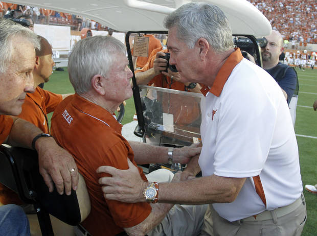 Texas coach Mack Brown, right, greets former head coach Darrell Royal befor the start of an NCAA college football game against Wyoming, Saturday, Sept. 1, 2012, in Austin, Texas.(AP Photo/Jack Plunkett) ORG XMIT: TXJP106