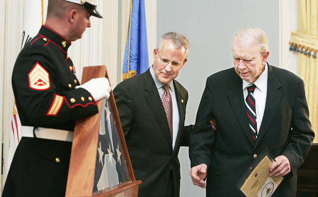In this 2008 photo, Gov. Brad Henry presents a flag flown over Iwo Jima, to former Gov. Henry Bellmon in the Blue Room of the Oklahoma state Capitol. Bellmon fought the battle of Iwo Jima. PHOTO BY JACONNA AGUIRRE, OKLAHOMAN ARCHIVE