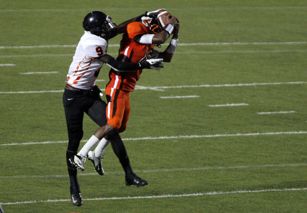 BTW's Cameron Durant (15) intercepts a pass intended for Douglass' wide receiver Glenn Banks (9) during the season-opener for both teams, at S.E. Williams Stadium, on Friday, Aug. 31, 2012. CORY YOUNG/Tulsa World