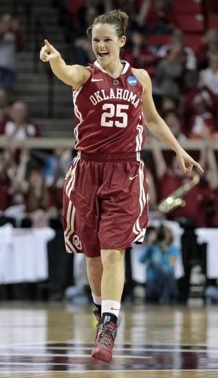 Oklahoma Sooners' Whitney Hand (25) points to a teammate after an assist as the University of Oklahoma Sooners (OU) play the St. John's Red Storm in the second round of the NCAA Women's Basketball Championship Tournament at the Lloyd Noble Center on Tuesday, March 20, 2012, in Norman, Okla. Photo by Steve Sisney, The Oklahoman