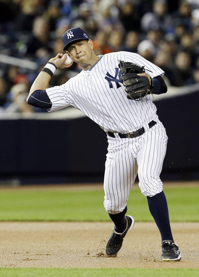 New York Yankees' Alex Rodriguez throws out Detroit Tigers' Omar Infante in the first inning during Game 1 of the American League championship series Saturday, Oct. 13, 2012, in New York. (AP Photo/Paul Sancya )