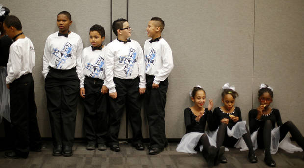 Dancers from Tulakes Elementary School rest backstage before performing at a dance competition at the Rose State Performing Arts Theatre in Midwest City. Photo by Bryan Terry, The Oklahoman <strong>BRYAN TERRY - THE OKLAHOMAN</strong>