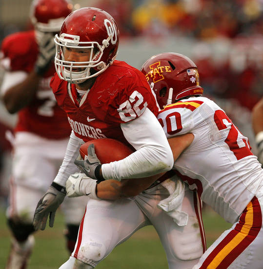 Oklahoma's James Hanna (82) runs after a catch as Iowa State's Jake Knott (20) pursues during a college football game between the University of Oklahoma Sooners (OU) and the Iowa State University Cyclones (ISU) at Gaylord Family-Oklahoma Memorial Stadium in Norman, Okla., Saturday, Nov. 26, 2011. Photo by Steve Sinsey, The Oklahoman