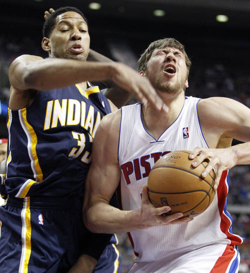 Detroit Pistons center Viacheslav Kravtsov, right, gets hit in the eye by Indiana Pacers forward Danny Granger, left, while going to the basket in the first half of an NBA basketball game Saturday, Feb. 23, 2013, in Auburn Hills, Mich. Granger was called for a foul on the play. (AP Photo/Duane Burleson)