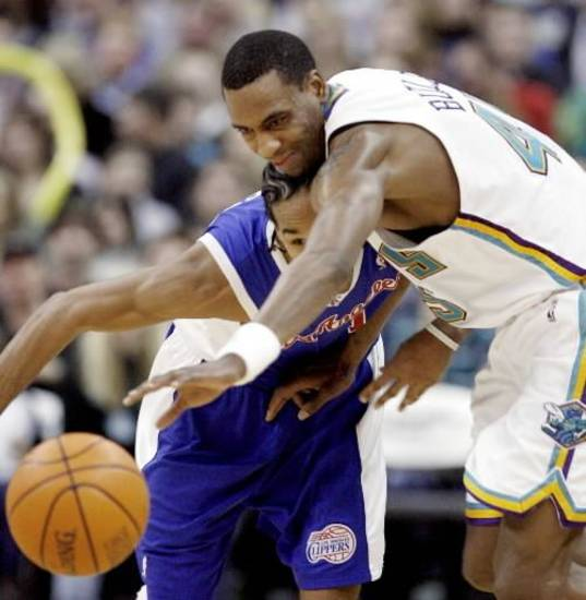 The Hornets' Rasual Butler, right, and the Clippers'  Shaun  Livingston go after a loose ball in the second during the NBA basketball game between the New Orleans/Oklahoma City Hornets and the Los Angeles Clippers at the Ford Center in Oklahoma City, Monday, Jan. 8, 2007. By James Plumlee, The Oklahoman