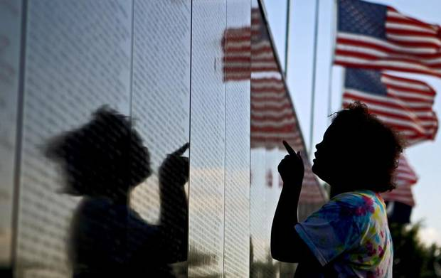 Aubrey McCray, 10, of Norman, looks over the Dignity Memorial Vietnam Wall before an opening ceremony at Reaves Park in Norman, Okla., Wednesday, June 30, 2010.  Photo by Bryan Terry, he Oklahoman ORG XMIT: KOD